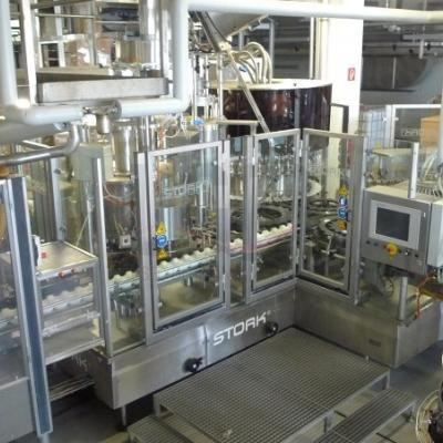 Complete filling line for glass- and plastic bottles with UHT autoclaves