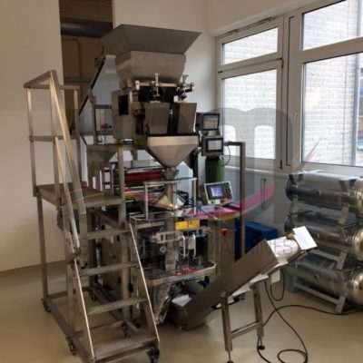 Used bag packaging machine including linear scale and thermal transfer printing